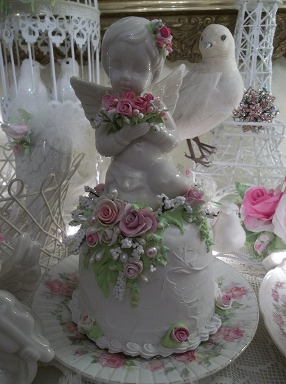 (Cupid Cake) Ceramic Angel Attached To A Fake Cake
